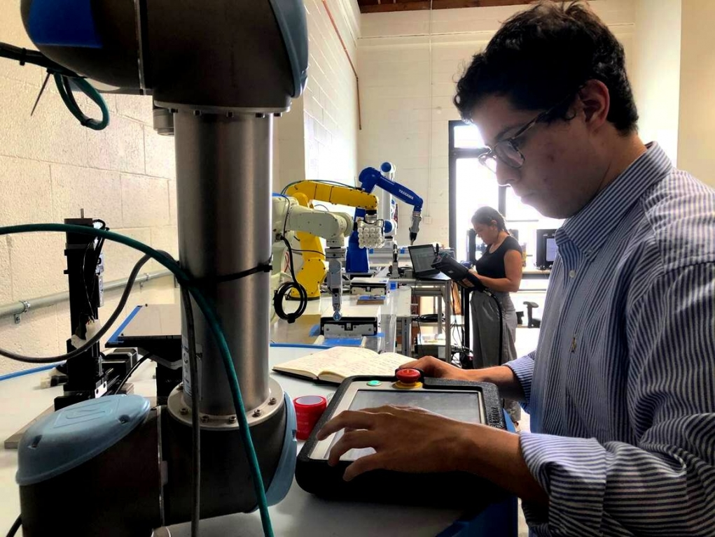 Angelo Moreno (Intern) and Lizzeth Sanche z (Robot Integration) testing Gecko Grippers  on  robot arms from Universal Robots  and Yaskawa