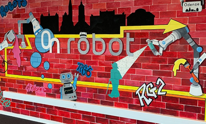 KAREN DODSON MURALS DECORATE ONROBOT OFFICES ALL OVER THE WORLD