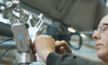GEAR MANUFACTURING COMPANY OSVALD JENSEN DECREASES CYCLE TIME BY 12 SECONDS USING DUAL GRIPPER FROM ON ROBOT